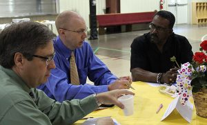 Shannon Newsome, Reidsville Christian Church talks with  Mark Wells of Rockingham County Business and Technlogy Center and Kenneth Moore, Sharon Missionary Baptist Church